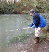 Brad Stone taking stream samples
